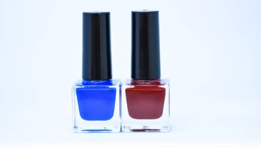 Beauty and care concept. Nail polish bottles different colors. Nail polish white background. Manicure salon. Durability and quality of nail polish coating. Gel polish modern technology. Fashion trend