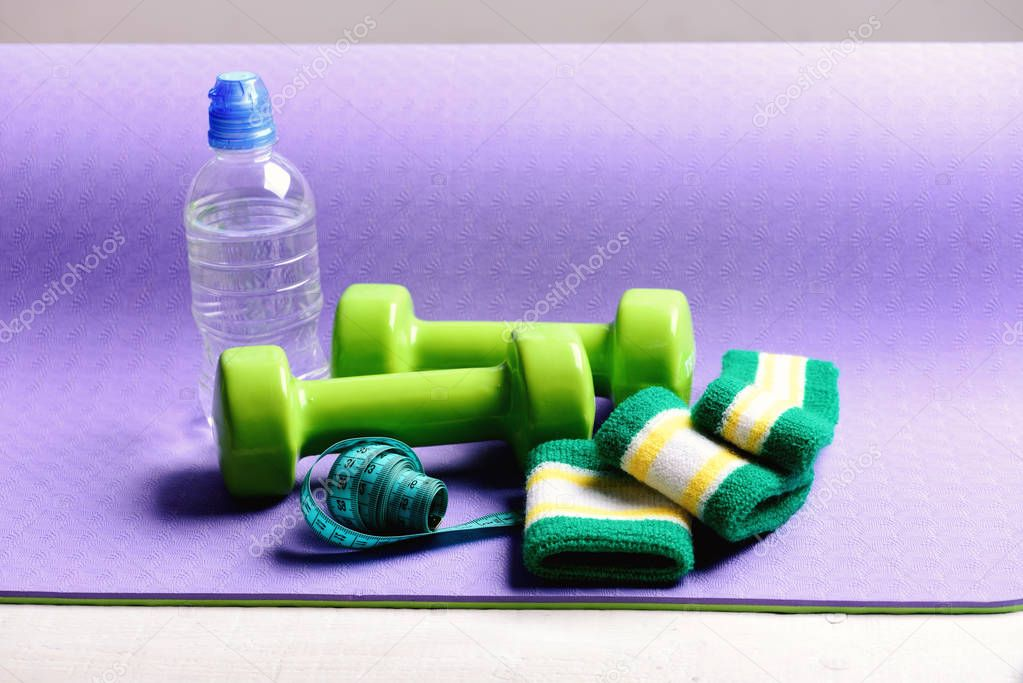 Dumbbells, water bottle, hand bands and measure tape