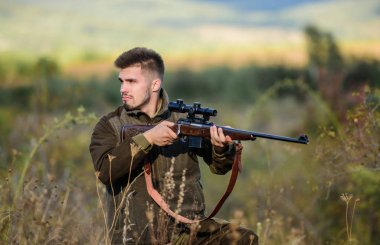 Hunting and trapping seasons. Hunting permit. Man brutal gamekeeper nature background. Bearded hunter spend leisure hunting. Hunter hold rifle. Focus and concentration of experienced hunter