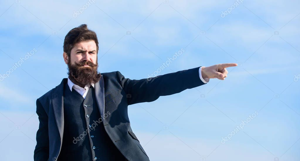 This way. Changing course. Business direction. Looking for opportunities and chances. Man formal suit manager looking direction. Developing business direction. Businessman bearded face sky background