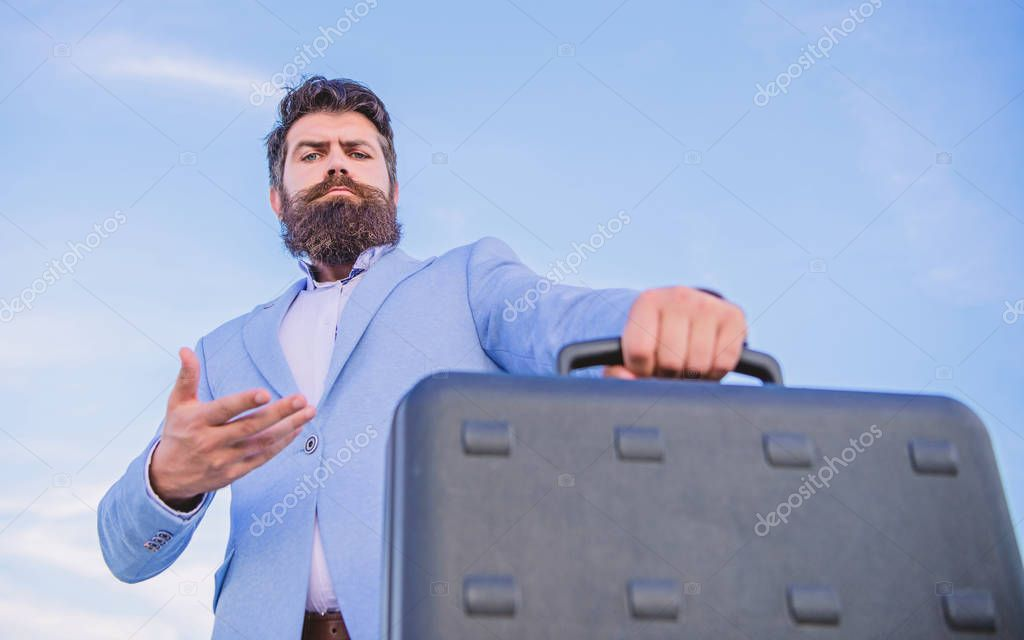 Business man formal suit carries briefcase sky background. Entrepreneur offer bribe. Illegal deal business. Hipster bearded face hold briefcase with bribe. Businessman presenting business case