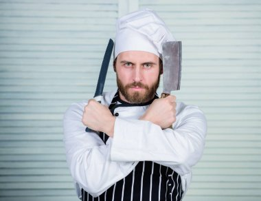 Ready to work. confident man in apron and hat hold knife. bearded man loves eating food. cook in restaurant, uniform. Professional in kitchen. culinary cuisine. chef ready for cooking