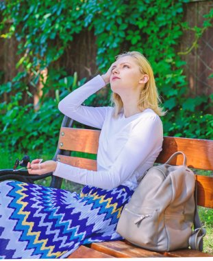 Girl sit bench relaxing in shadow, green nature background. Woman blonde take break relaxing in park. Why you deserve break. Ways to give yourself break and enjoy leisure. Feeling free and relaxed