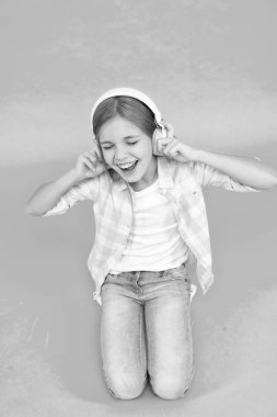 Childhood happiness. Mp3 player. small kid listen ebook, education. childrens day. Audio technology. small girl child in headphones. Listen to music. Beauty. Good music increases my productivity
