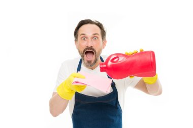Keeping his home clean. Shocked cleanup man pouring home laundry detergent on wiper. Mature home keeper with open mouth wearing rubber gloves. Providing services of home cleaning and laundry