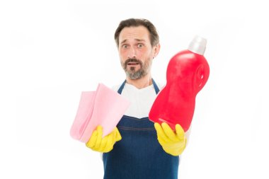 Cleaning and maintenance Senior man holding bottle of domestic cleaning fluid and wiper. Mature man doing household activity. Household worker. Household laundering. Providing household service