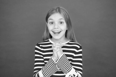 Believe in miracle. Child girl dreaming her wish come true. Miracle happens. Little girl smiling full of hope. My secret wish. Make a wish. Hope for the best. Girl hopeful excited face making wish
