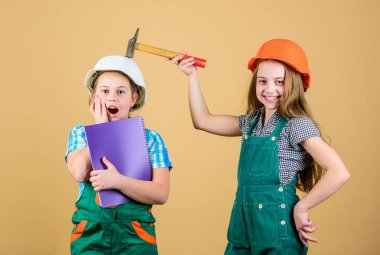 Children sisters renovation their room. Control renovation process. Kids happy renovating home. Home improvement activity. Kids girls with tools planning renovation. Family remodeling house