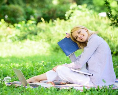 Girl with business diary create her daily schedule. Woman relax nature background. Save time for relax. Create break for yourself. Smart time management. Save your time. Time management skill