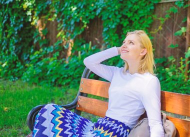 Girl sit bench relaxing in shadow, green nature background. Why you deserve break. Ways to give yourself break and enjoy leisure. Woman blonde take break relaxing in park. Peace and tranquility