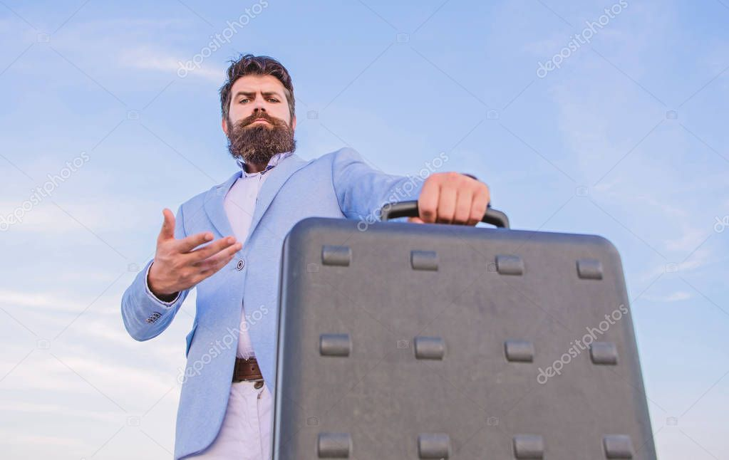 Illegal deal business. Hipster bearded face hold briefcase with bribe. Business man formal suit carries briefcase sky background. Businessman presenting business case. Entrepreneur offer bribe