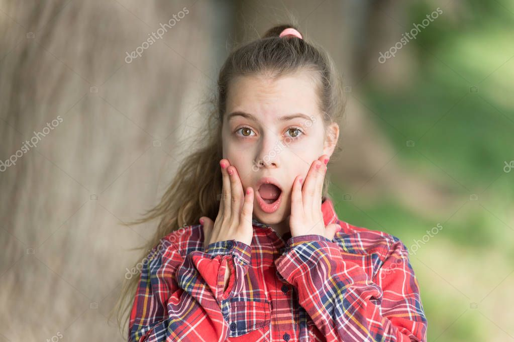 Wow shocking news. Kid long hair walking. Summer holidays. Little child enjoy walk. Surprise suits her. International childrens day. Surprising all the way. Surprise concept. Girl carefree child