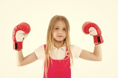 Cute boxer. Girl on dreamy calm face posing with boxing gloves, isolated white background. Kid long hair dreaming to be strong and independent. Independence concept. Child dreams power and victory