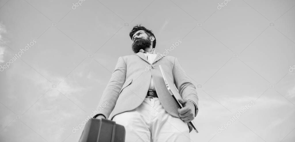 Businessman presenting business case. Business man formal suit carries briefcase sky background. Entrepreneur offer bribe. Hipster bearded face hold briefcase with bribe. Illegal deal business