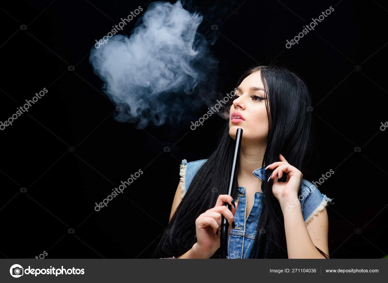 Bad habit  Woman vapor  exhale smoke on black background