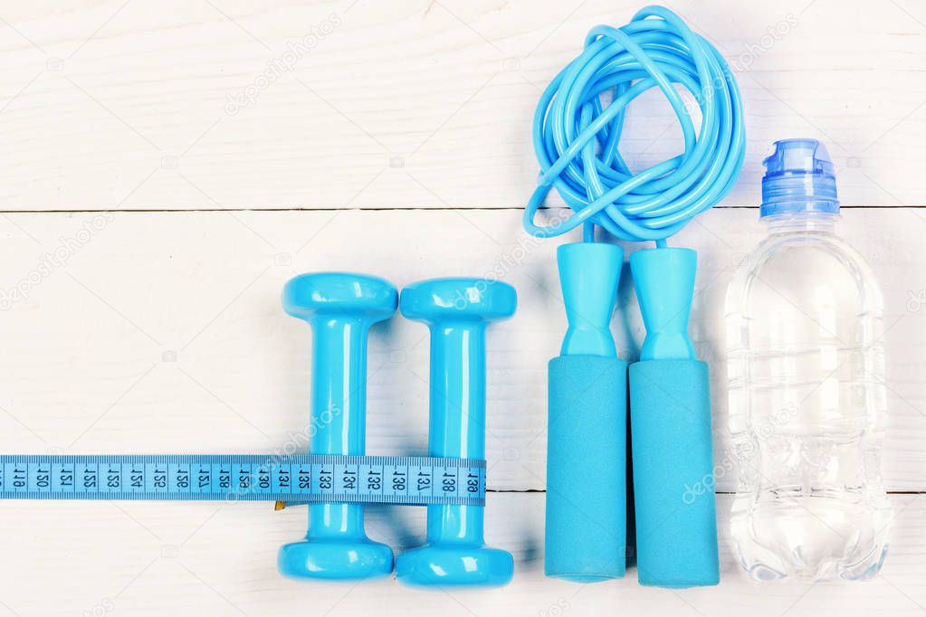 Gym tools on white backdrop. Sports equipment in cyan blue
