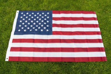 Make America great again. American flag green grass background. National symbol. American citizenship and patriotism. American unity. 4th of July. Independence day. American symbol. Stripes and stars