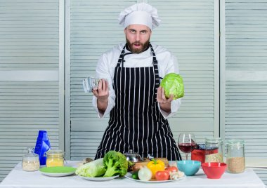 have no skills. green fresh ingredients. bearded man loves healthy food. cook in restaurant. professional chef cooking in kitchen. organic and vegetarian. Dieting and vitamin. culinary cuisine