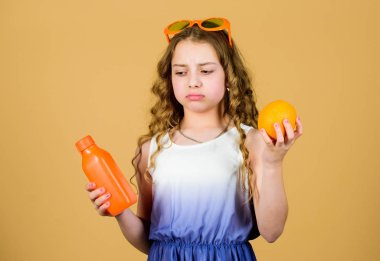 Vitamin nutrition. refreshing vitamin juice. Summer vitamin diet. Natural vitamin source. sad girl drink fresh orange juice. summer vacation. little girl in fashion glasses. Slice of summer goodness