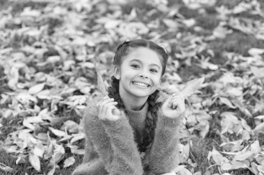 Happy childhood. School time. Happy little girl in autumn forest. Autumn leaves and nature. Small child with autumn leaves. I would stay here forever. No rush. Real relaxation. Feeling comfortable