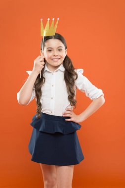 her pride. little girl in uniform with crown prop. kid fashion beauty. luxury and future success. selfish child egoist. best motivation. prom queen winner. big boss. true lady. back to school
