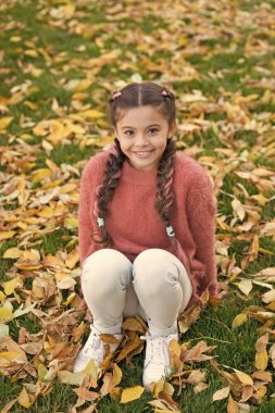Happy little girl in autumn forest. Autumn leaves and nature. Happy childhood. School time. Small child with autumn leaves. I would stay here forever. Quit morning. Lucky to start the day here