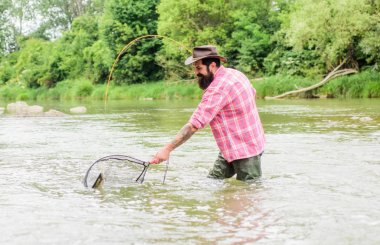 fishing zone. fisherman with fishing rod. bearded fisher in water. summer weekend. Big game fishing. mature man fly fishing. man catching fish. hobby and sport activity. pothunter