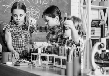 School education. School chemistry experiment. School club. Explaining chemistry to kid. Fascinating chemical reaction. Teacher and pupils with test tubes in classroom. Interesting school classes