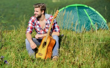 Musician looking for inspiration. Summer vacation highlands nature. Dreamy wanderer. Pleasant time alone. Peaceful mood. Guy with guitar contemplate nature. Wanderlust concept. Inspiring nature