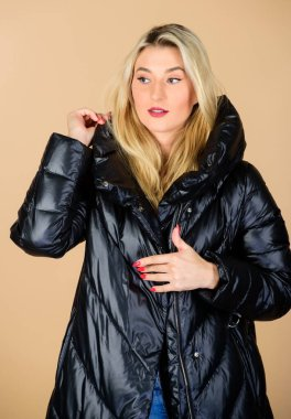 Gorgeous. happy winter holidays. Xmas coming. woman in padded warm coat. flu and cold. seasonal fashion. beauty in winter clothing. cold season shopping. girl in puffed coat. faux fur fashion