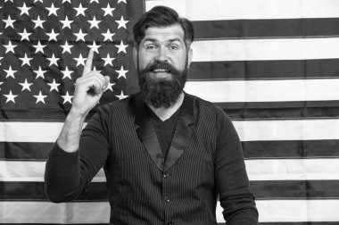 Idea and ideology. Patriotic concept. American lawyer teacher speaker or tv host american flag background. Love homeland. Man with beard and mustache with american flag. Make America great again