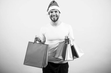 delivery christmas gifts. The morning before Xmas. happy santa man on yellow background. online christmas shopping. Happy new year. man in santa hat hold christmas present. Are you ready