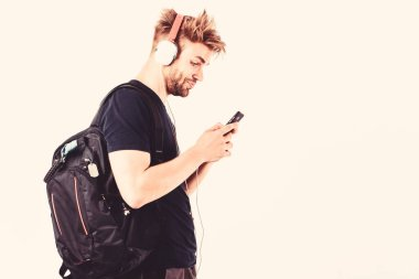 He is OK with technology. mp3 player. sexy muscular man listen music on phone mp3 player. man with mp3 player on phone isolated on white. unshaven man in headphones