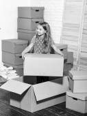 Move out concept. Prepare for moving. Packaging things. Excited about new house. Sweet home. Rent house. Family house. Delivering service. Apartment for family. Moving out. Girl child play box