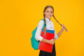 Photo Private schooling. Teen with backpack. Cute smiling schoolgirl. Girl little schoolgirl carry backpack. Pupil with long braids going to school. Totally ready. Schoolgirl daily life. School club