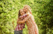 True friendship. Girls smiling happy faces hug each other. Girls children best friends hug. Sisterhood love and support. Happy childhood. Hug and love concept. Kids happy together nature background