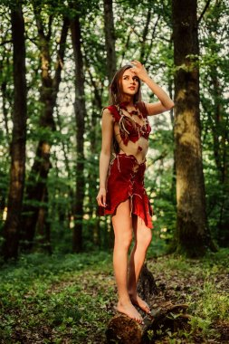 the woman went hunting. cougar female. wild woman in forest. ethnic tribal fashion. deep forest. sexy girl in leather suede clothes. amazon woman. sexy witch. Unpassable to resist