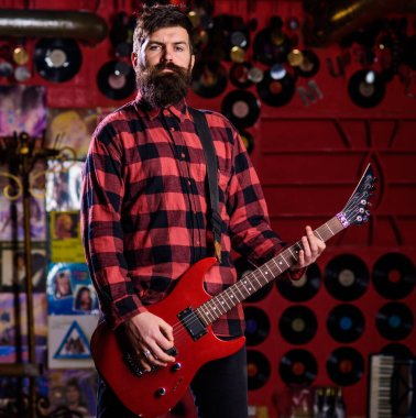 Frontman concept. Musician with beard play electric guitar