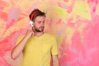 Cheerful teenage dj listening songs via earphones. Musical lifestyle.
