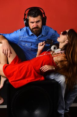 Party and music concept. Couple in love wears headphones