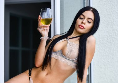 passion and lust. Woman seductive model enjoy wine. Seminude girl with alcohol. body of a woman in sexy lingerie with wine glass. beautiful sexy girl with glass of wine. Hot lady in lace lingerie