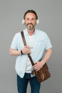 Get the very best audio experience. Bearded man listen to music grey background. Mature male wear audio headphones. Hi-Fi audio device. Listening to audio podcast. New technology. Modern life