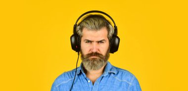 Blogger becoming inspired. listen audio book. Music beat for energetic mood. his favorite song. excellent sound song in earphones. good mood playlist. Man with headset. bearded man hipster in headset