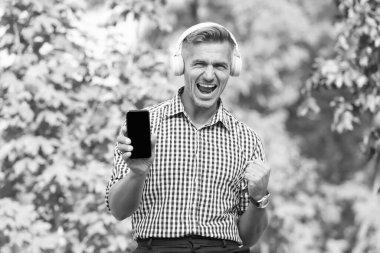 Digital influencer. Online communication. Personal blog social networks. Podcast business development. Podcast for manager. Musical service. Handsome well groomed man listening podcast. Online blog