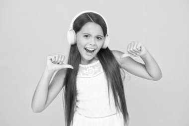 Favorite track. Add song to playlist. Listening music. Girl with headphones. Modern technologies concept. Happy child in earphones. Audio concept. Kid enjoy modern music. Buy new music device