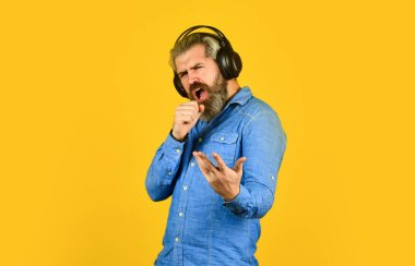 Singer on rehearsal. Music beat. Noise cancelling function. Man bearded hipster headphones listening music. Dj hipster. Excellent music playlist. Hipster enjoy excellent sound song in earphones