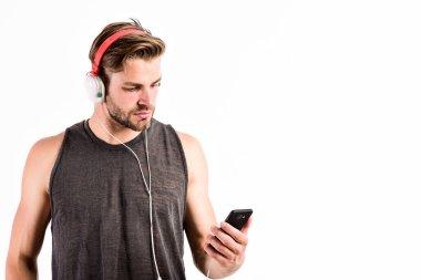 Inspiring music concept. Man handsome unshaven hipster listen music using headphones gadget. Modern earphones. Music application smartphone. Listen music for motivation and inspiration. Audio quality