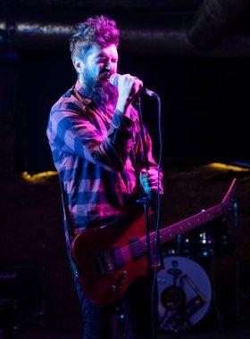 Frontman concept. Young rock musician, singer. Musician