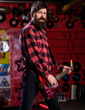 Young rock musician, singer, talented artist. Frontman concept.