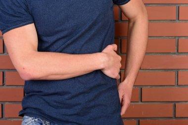 Guys arm in dark blue tshirt put on left side.